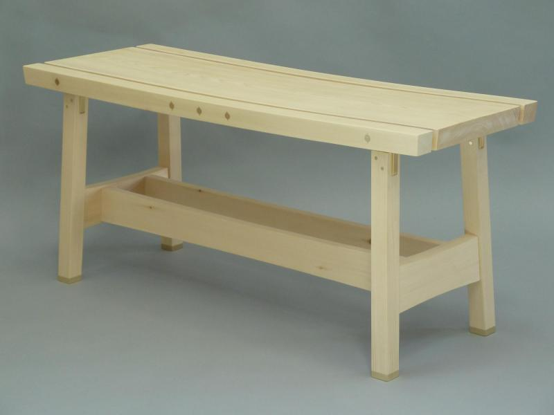 Front view of CT Garden Bench in port orford cedar and brass