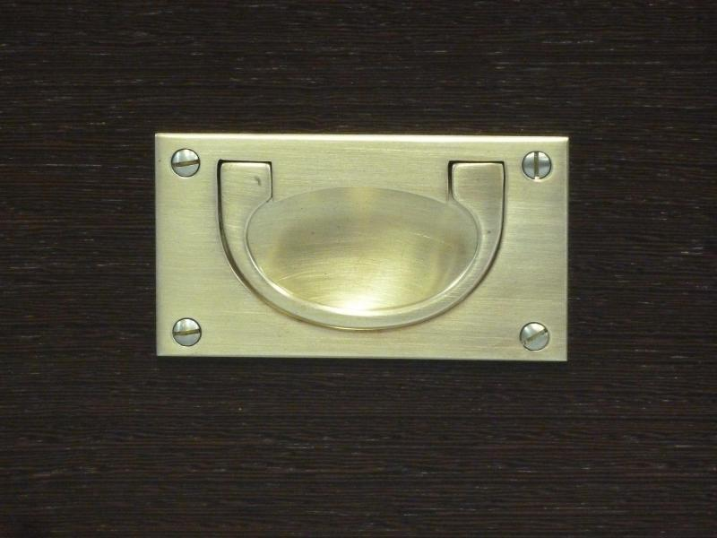 Brass loop handle used on a drawer